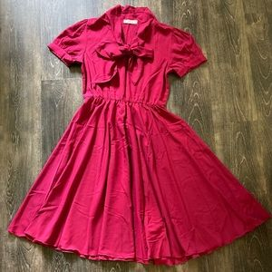 Vintage style berry colored midi dress with bow